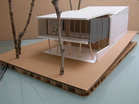 Screened guest house extends into low tree canopy