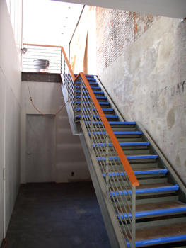 Main entry stair during construction.  Blue tape protects tread edges.