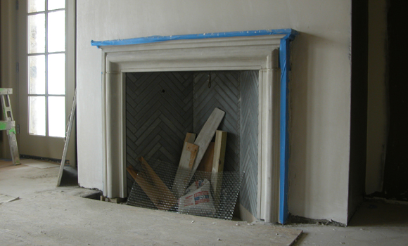 Dining room fireplace with herringbone soapstone interior ... and site debris